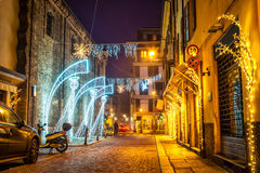 Night street decorated with lighting angels in Parma Royalty Free Stock Photo