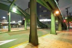 Night street. Empty night street with well illuminated metallic bridge structure Stock Photo