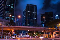 Night street of Hong Kong city center. Night cityscape with blurred car lights on the street of Hong Kong city center royalty free stock photography