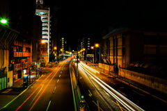 Night Street Moment Captured of little road in Osaka, Japan. Osaka, Japan - August 05, 2014 : Night street moment of the traveling cars are captured of little Royalty Free Stock Photo