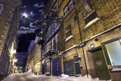 Night Street Patrol. A drone with a camera is flying along a deserted street in a winter night Stock Photos