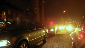 Night street - police cars waiting on city winter road stock video