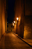 Night street in Prague. Empty night small street in Prague illuminated by lanterns Stock Image