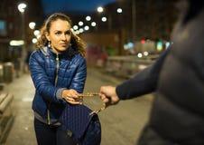 Night street robbery scene Stock Photography