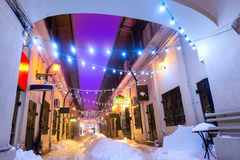 Night street scene in Bucharest old city, with christmas lights Royalty Free Stock Photo