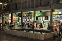 Night street with shops Royalty Free Stock Image