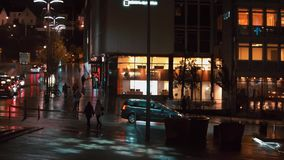 Night street view. Cars and people stock video footage