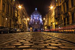 Rue Royale with Sainte-Marie church in Schaerbeek, Brussel. Night street view of the Rue Royale with Sainte-Marie church in Schaerbeek, Brussel, Belgium Stock Photo