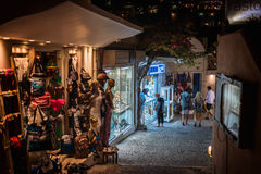 Night streets with many open souvenir shops at Thira town Royalty Free Stock Image