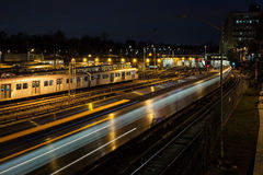 Night Subway Train Leaving Station. A photo of a silver subway train speeding by at night Stock Photography