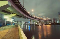 Night at Sumida river. Empty embankment with hanged highway structure by night at Sumida river in Tokyo, Japan Stock Photos