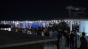Night summer Club near Pool when People Blurred and relaxing under the sky stock video