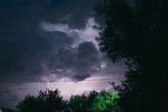 Night summer thunderstorm in the countryside. Night landscape Stock Photo