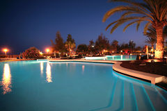 Night swimming pool. Hotel with blue pool shot at the night royalty free stock photos