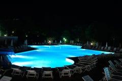 Night swimming pool Stock Images