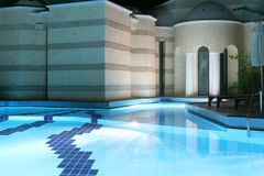 Night swimming pool Stock Images