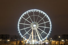 Night takes the Ferris wheel of the gardens of the Tuileries stock images
