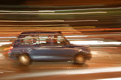 Night Taxi. London Black Cab with nighttime motion blur Stock Image