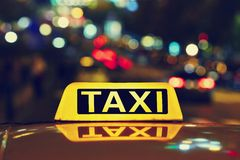 Night taxi. Taxi car on the street at night stock photos