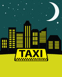 Night taxi in the city on the background of skyscrapers. Royalty Free Stock Photo