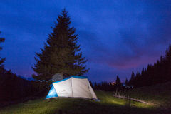 Night at tent Stock Images