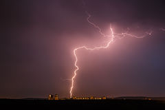 Night thunder lightning over the city sky. View Stock Image