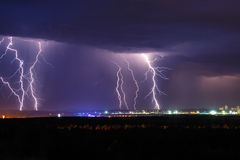 Night thunder lightning over the city sky. View Royalty Free Stock Images