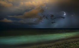 Night thunderstorm over the sea. Stock Photography