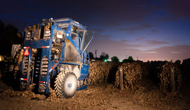 Night Time Agriculture Fruit Harvest Grape Harvesting Machine. A large harvesting machine lined up ready to harvest ripe grapes after an early freeze Royalty Free Stock Photo