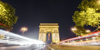 Arc de Triomphe and car light trails at night. Night time in Arc de Triomphe, car light trails, long exposure Stock Photo