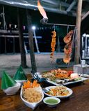 Night time beach barbecue for two with fire stock image