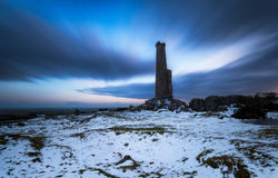 Night time on Bodmin Moor. A long exposure of a ruined chimney stack under a dramatic night sky on Bodmin Moor in Cornwall Stock Photo