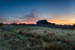 Night time on Bodmin Moor. An old barn just after dusk on Bodmin Moor in Cornwall royalty free stock image