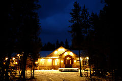 Night Time Cabin in the Woods Wilderness Lights Glowing Warmth Stock Images