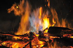 Night time, campfire. A roaring campfire, showing an abstract shape in the flames, of a Scotty dog. There was no manipulation in this image, and was photographed Royalty Free Stock Photos