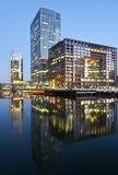 Night-time in Canary Wharf, London. Night time in Canary Wharf in London with reflections on the water Royalty Free Stock Photography