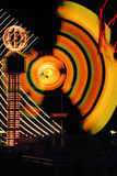 Night Time Carnival Lights. Rides in motion at a nightime carnival create a blur of fantastic lights and colors Stock Images
