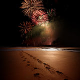 Night time celebration. With prints in the sand Stock Image