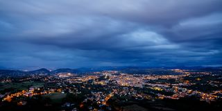 Night time with the city lights of Le Puy-en-Velay. Le Puy-en-Velay, the capital of the department Haute-Loire in the Auvergne, France at night. The city spreads royalty free stock image