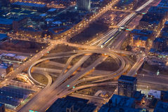 Night time cloverleaf ramps. Cloverleaf expressway ramps and city streets at night Stock Photo