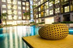 Night time of condominium and swiming pool Royalty Free Stock Photos