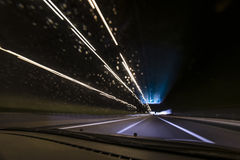 Night time highway. View from within a car while cruising a motorway on a rainy night Royalty Free Stock Photos