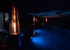 Night time  home outdoor patio and pool patio Royalty Free Stock Images