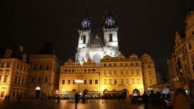 Night time illuminations of the fairy tale Church of our Lady Tyn (1365) in the Magical city of Prague. Czech republic stock video