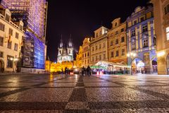Night time illuminations of the magical Old Town Square in Prague, visible are Kinsky Palace and gothic towers of the Church.  royalty free stock photos