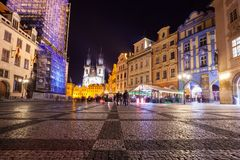 Night time illuminations of the magical Old Town Square in Prague, visible are Kinsky Palace and gothic towers of the Church.  stock images