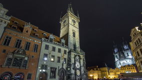 Night time illuminations of the the Old Town Hall timelapse hyperlapse, Town Square and fairy tale Church of our Lady stock footage