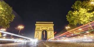 Impressive Arc de Triomphe and car lights at night. Night time in the impressive Arc de Triomphe, car lights, long exposure Royalty Free Stock Photography