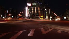 Night time lapse, cars leave light traces, moving on crossroads. Stock footage stock video