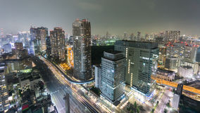Night Time-Lapse of downtown in Tokyo with trains stock footage